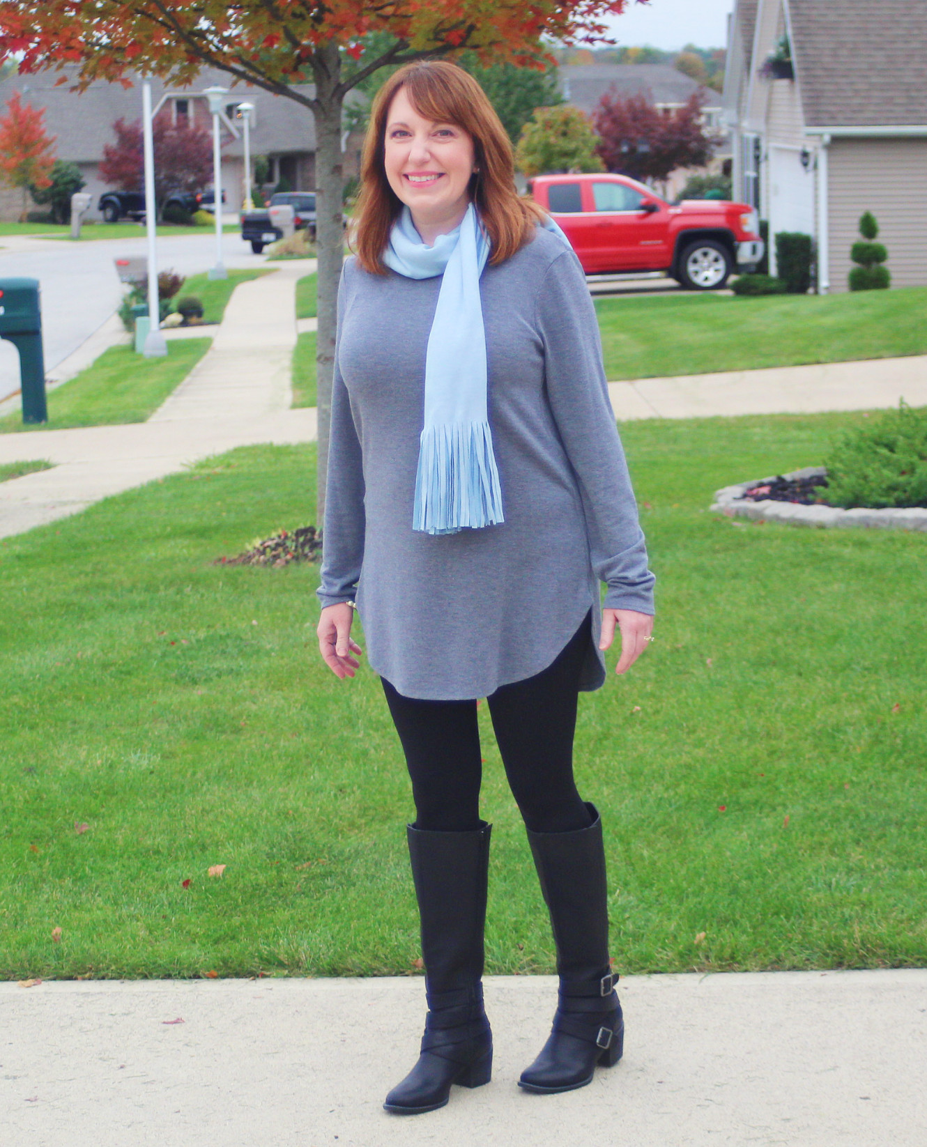 Gray Tunic And Tall Black Boots
