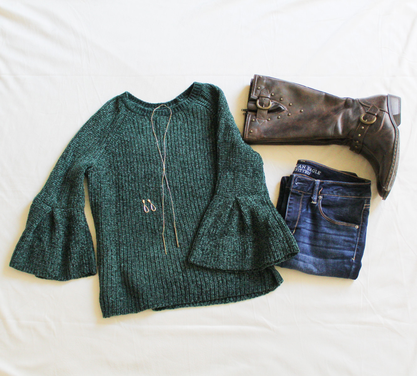 Green Sweater, Jeans, Boots, Earrings, And Necklace