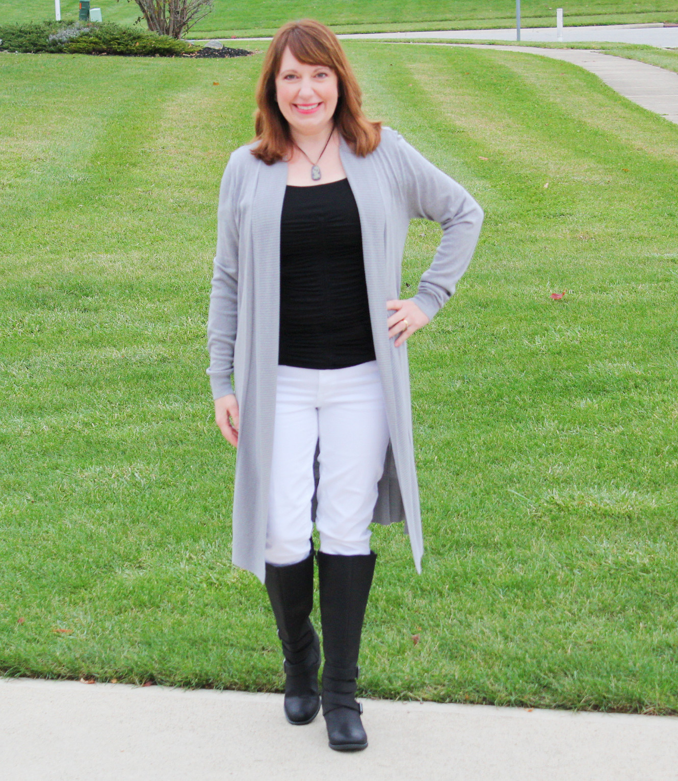 Gray Cardigan With Black Top, White Jeans, And Black Boots