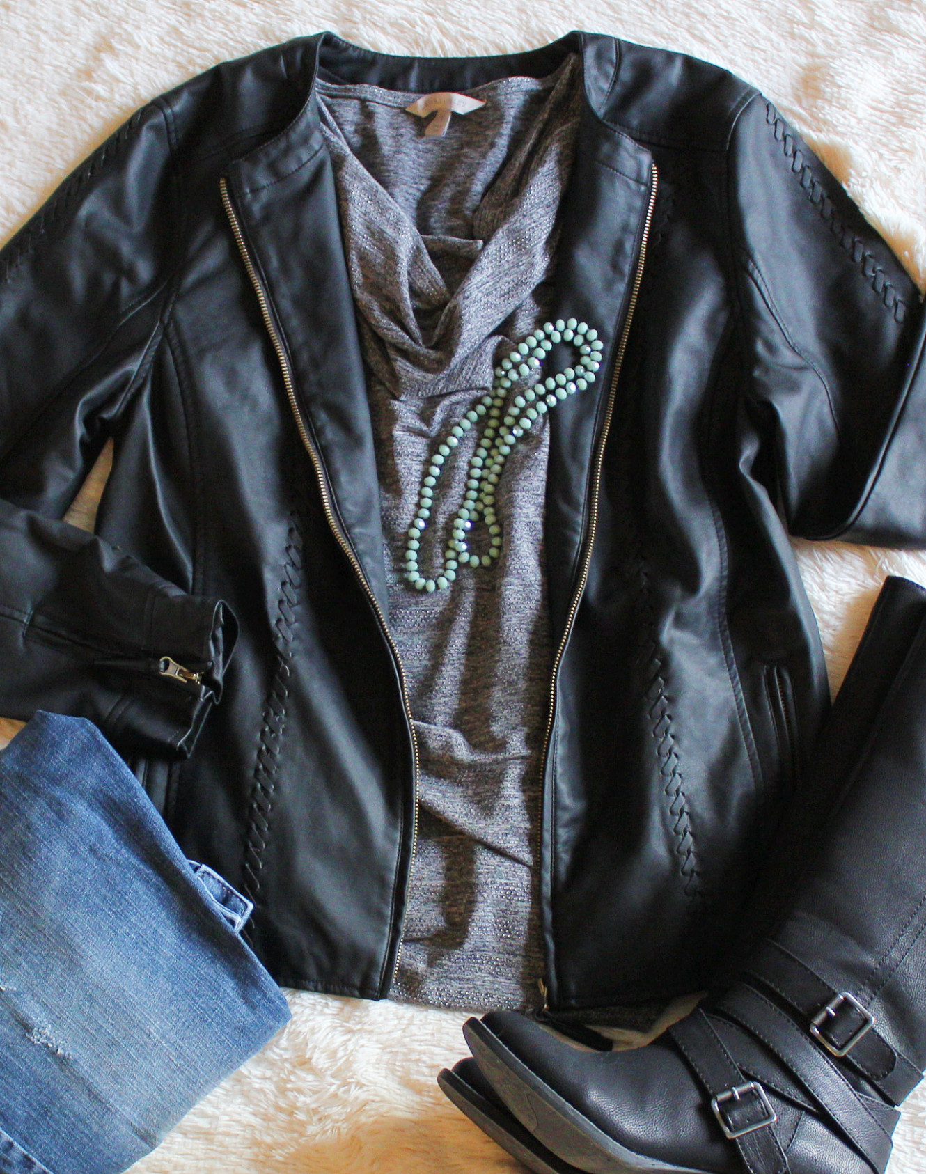 A Winter outfit featruing a faux leather jacket and green beaded necklace. Fashion/Jewelry/Winter Outfit