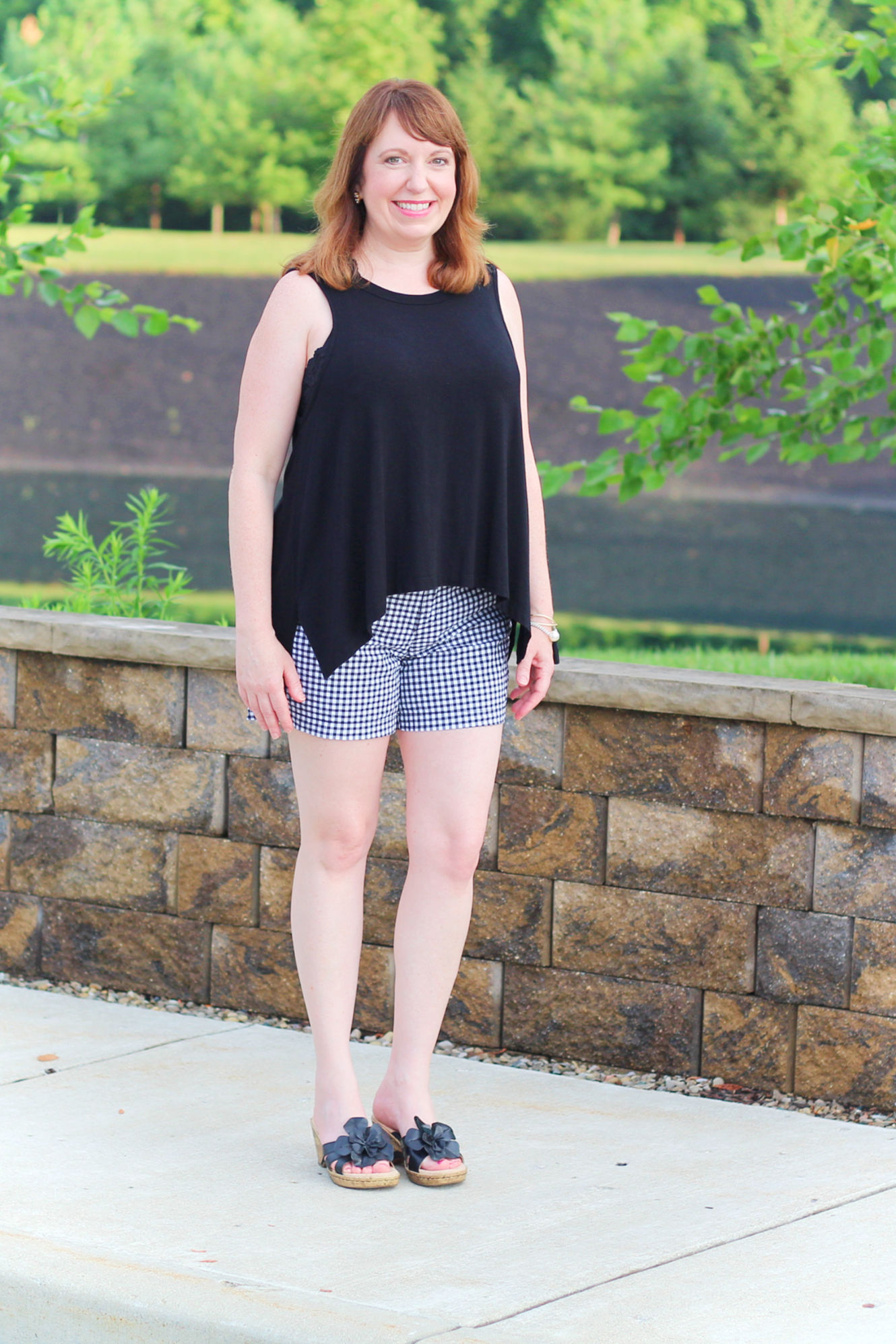 f54b7cc2fa8303 Black And White Shorts Outfit With A Bralette  fashionover40   fashionforwomenover40  summeroutfit  bralette